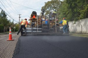Resurfacing asphalt road