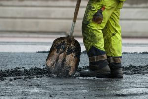 Asphalt workers on a road construction